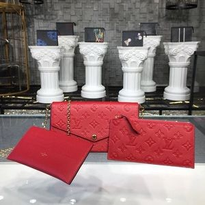 Louis Vuitton felicie empreinte crossbody red
